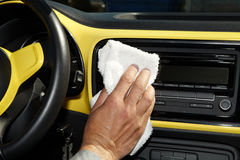 Cleaning the car. Hand with microfiber cloth Royalty Free Stock Photos