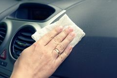 Cleaning car interior with cloth Royalty Free Stock Photo