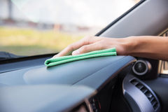 Cleaning the car interior with green microfiber cloth Royalty Free Stock Photography