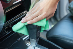 Cleaning the car interior with green microfiber cloth Stock Photo
