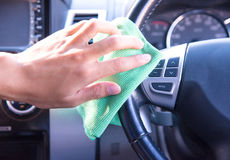 Cleaning the car interior with green microfiber cloth Stock Image