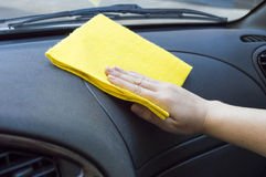 Cleaning the car interior. Man cleaning the car interior with yellow cloth Stock Photography