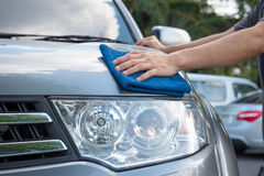 Cleaning the car. Cleaning the  car with microfiber cloth and wax coating Stock Photo