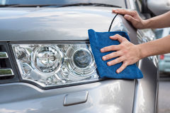 Cleaning the  car with microfiber cloth. And wax coating Royalty Free Stock Photo