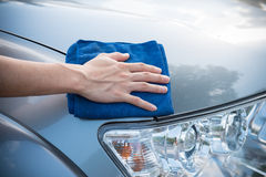 Cleaning the  car with microfiber cloth Stock Photos