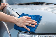 Cleaning the  car with microfiber cloth Stock Photo