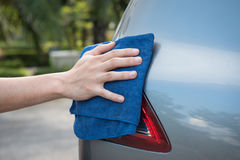 Cleaning the  car with microfiber cloth Royalty Free Stock Photography