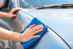 Cleaning the car. With microfiber cloth and wax coating Stock Photos