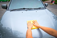 Cleaning the car with microfiber cloth and wax coating. Support web design and car wash Royalty Free Stock Photos