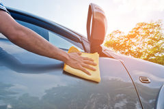 Cleaning the car with microfiber cloth and wax coating,vintage color tone. Support web design and car wash Stock Images