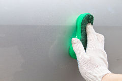 Cleaning the car. With a sponge Royalty Free Stock Image