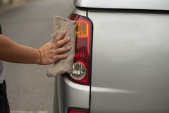 Cleaning car,taking care and cleaning. Cleaning wheel car,taking care and cleaning his new car Royalty Free Stock Photos
