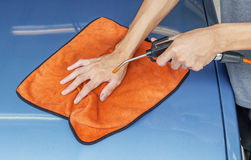 Cleaning Car Using Microfiber Cloth And Air Blower. Worker Cleaning Car Using Microfiber Cloth And High Pressure Air Blower Royalty Free Stock Photography