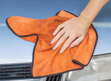 Cleaning Car Using Microfiber Cloth. Worker Use Right Hand Cleaning Car Using Microfiber Cloth Royalty Free Stock Images