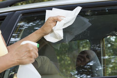 Cleaning car window Royalty Free Stock Photo