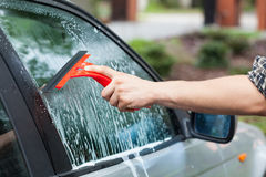 Cleaning car window Stock Photo
