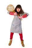 Cleaning the carpet. Housewife is very angry with carpet beater in hands royalty free stock images