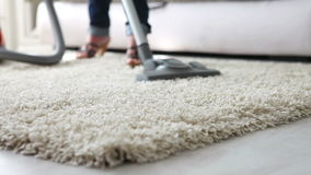Cleaning the  carpet with vacuum cleaner before couch - close up stock video footage