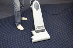 Cleaning the carpet vacuum cleaner Royalty Free Stock Photo