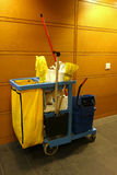 Cleaning Cart. A commercial cleaning cart, with a broom, paper towels and other supplies stock photo