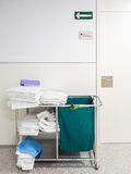 Cleaning cart of housekeeper or maid in hospital. Cleaning cart of housekeeper or maid with towels in hospital Royalty Free Stock Photography