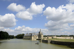 Cleaning the castle lake. Chantilly  is a commune in the Oise department in the valley of the Nonette in the Picardy region of northern France. Surrounded by Royalty Free Stock Images