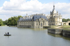 Cleaning the castle lake. Chantilly  is a commune in the Oise department in the valley of the Nonette in the Picardy region of northern France. Surrounded by Stock Images