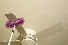 Cleaning ceiling fan Royalty Free Stock Photo