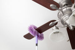 Cleaning ceiling fan. In the house Royalty Free Stock Photos