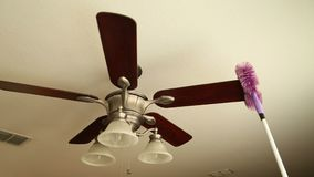 Cleaning ceiling fan stock video footage