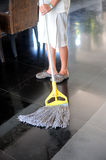 Cleaning a ceramic floor Royalty Free Stock Images