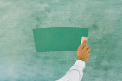 Cleaning the chalkboard Royalty Free Stock Photography