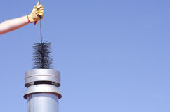 Cleaning chimney with sweeper sky background Royalty Free Stock Images