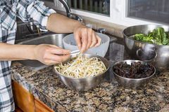 Cleaning Chinese bean sprouts Stock Photography