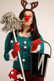 Cleaning after Christmas. Woman wearing festive decorations ready for cleaning after Christmas stock photo