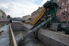 Cleaning the city canal bottom Stock Image