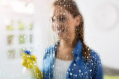 Cleaning - cleaning window pane with detergent. Cleaning window pane with detergent Stock Image