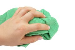 Cleaning cloth. Green  microfiber cloth with female hand Stock Photography