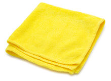 Cleaning cloth. A yellow microfiber cleaning towel, over white background Stock Photo
