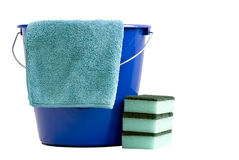 Cleaning cloth  a blue bucket and 3 scrubbers Royalty Free Stock Images