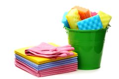 Cleaning cloths and bucket with colored sponges. Royalty Free Stock Photos