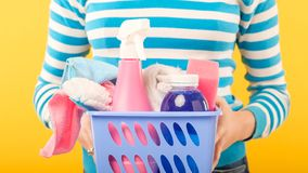 Cleaning company professional home cleanup woman. Cleaning company. Professional home cleanup. Woman with basket of supplies royalty free stock photo