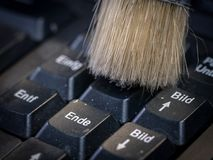0617 Cleaning the computer keyboard with a brush stock photography