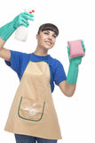 Cleaning Concept: Caucasian Woman Spraying Liquid Cleaner Over t Royalty Free Stock Image