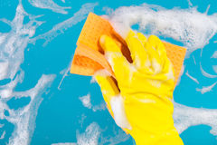 Hand with a rag cleans the surface. Cleaning concept, hand with a rag cleans the surface Stock Images