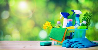 Cleaning concept. Housecleaning. Cleaning supplies on wooden board stock image