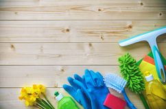 Cleaning concept. Housecleaning. Cleaning supplies on wooden board royalty free stock images