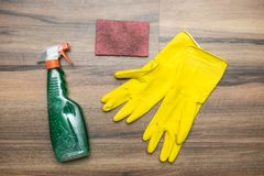 Cleaning concept. Cleaning tools: spray, rubber gloves and sponge. Stock Photos
