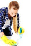 Cleaning concept. Young woman cleaninc. Stock Photos