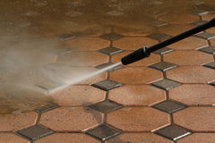 Cleaning concrete block floor Royalty Free Stock Images